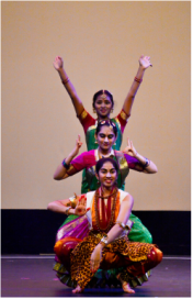 Three teenage girls performing a native Indian dance.